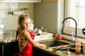 child-washing-dishes